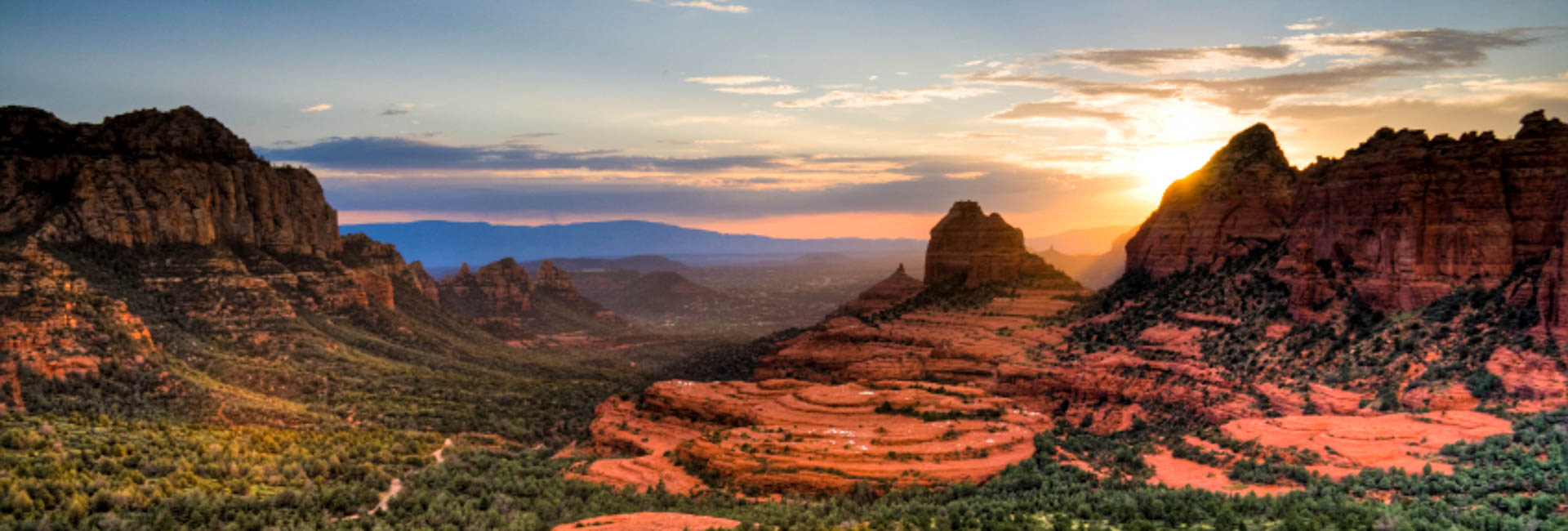 Sunsets over Sedona light up the red rock scenery on this private guided hiking tour.