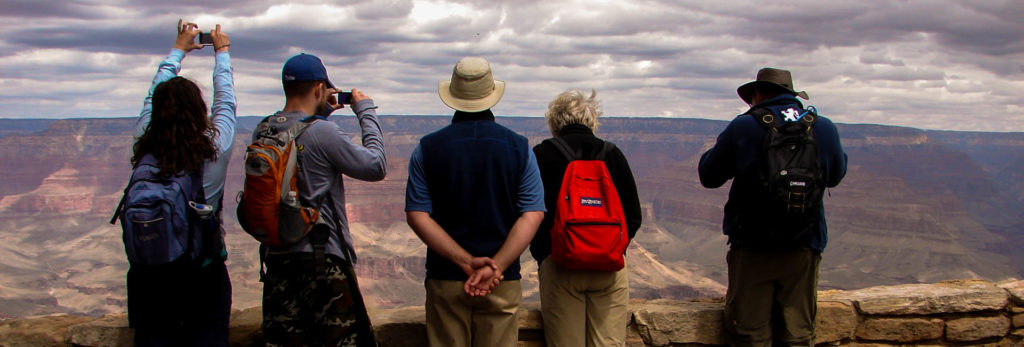 Hikers take a look off the South Rim in anticipation of their grand canyon backpacking tour.