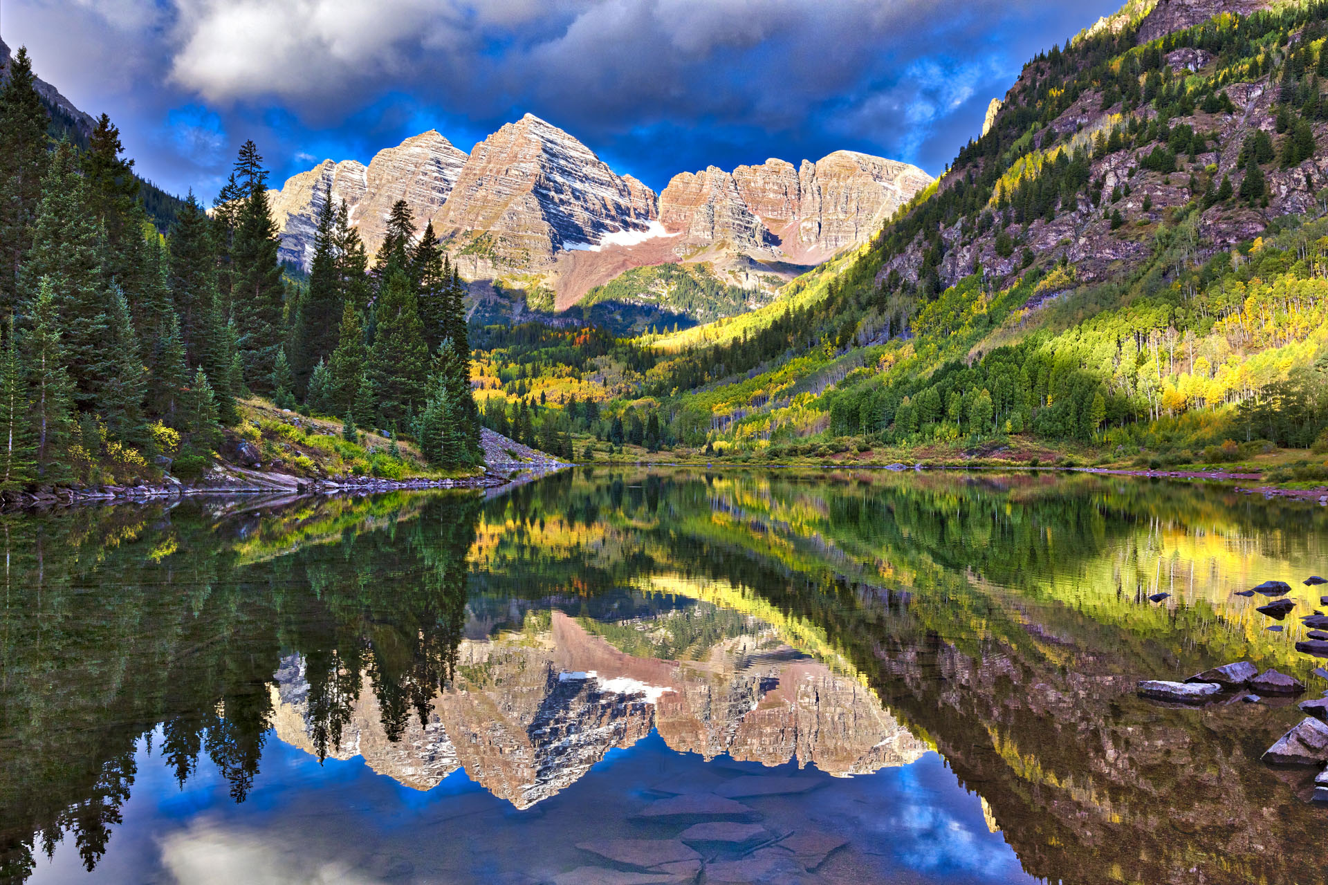 Lake reflection of Autumn colors at Maroon Bells outside Aspen Colorado.